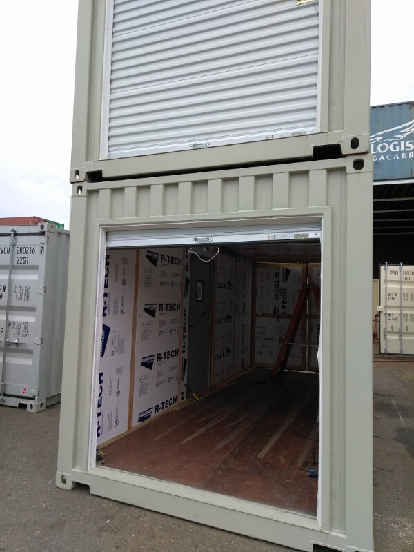 Shipping container insulated door